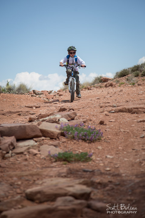 child mountain biking Moab